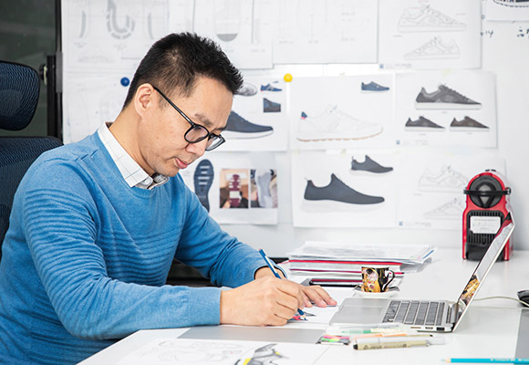 Casual shoe designer creating a new design